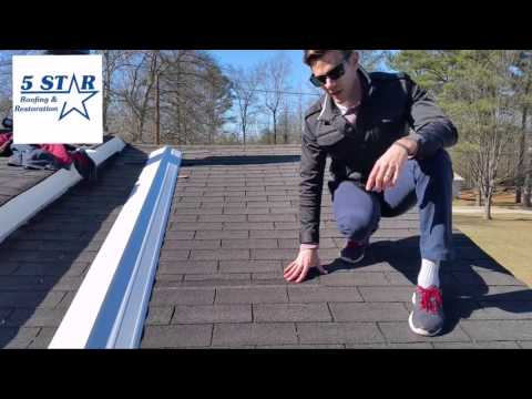 Signs of wind damage on a shingle roof