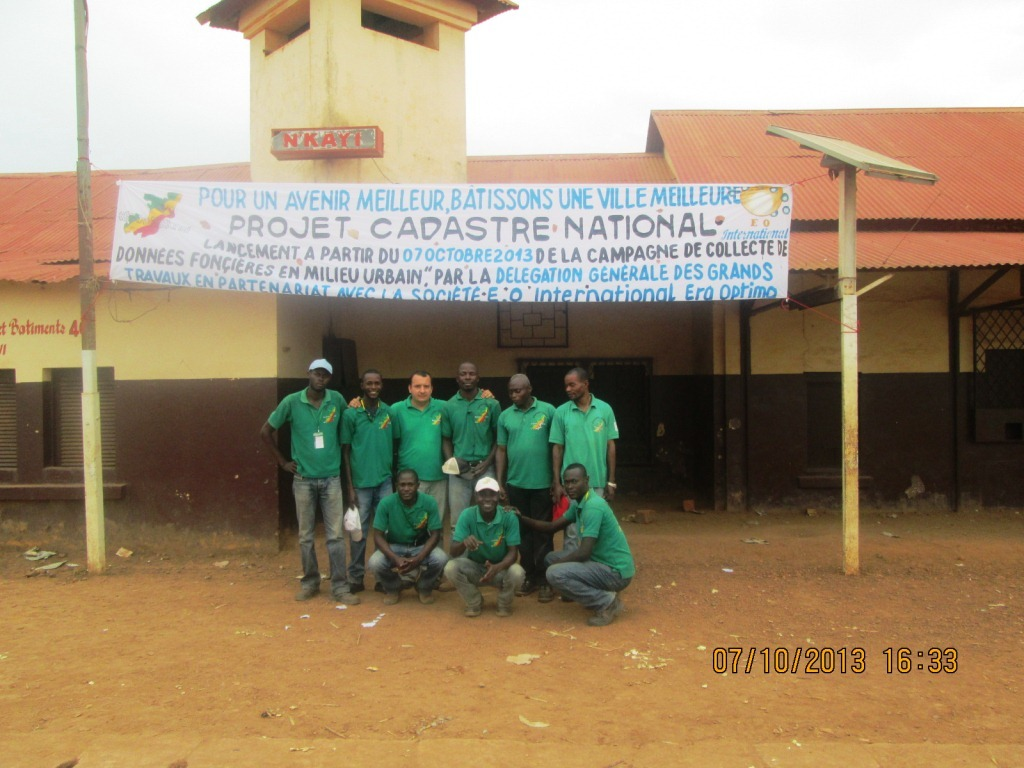 Group Picture with the banderole in front of the Train Station of Nkayi.