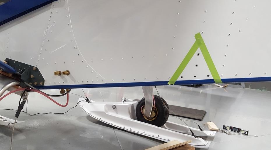 Rear ski cable bracket location
