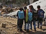 img_ce4074db85_gaza_children_walking_ruins