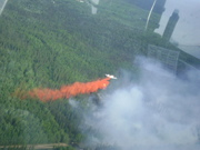 P-3_Orion_Air_Tanker_drops_retardant_on_fire,_provided_by_Division_of_Forestry_Air_Attack