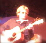 Kevin Odegard author Simple Twist of Fate playing guitar bought at Manny's for Dylan