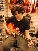 My son tries first guitar