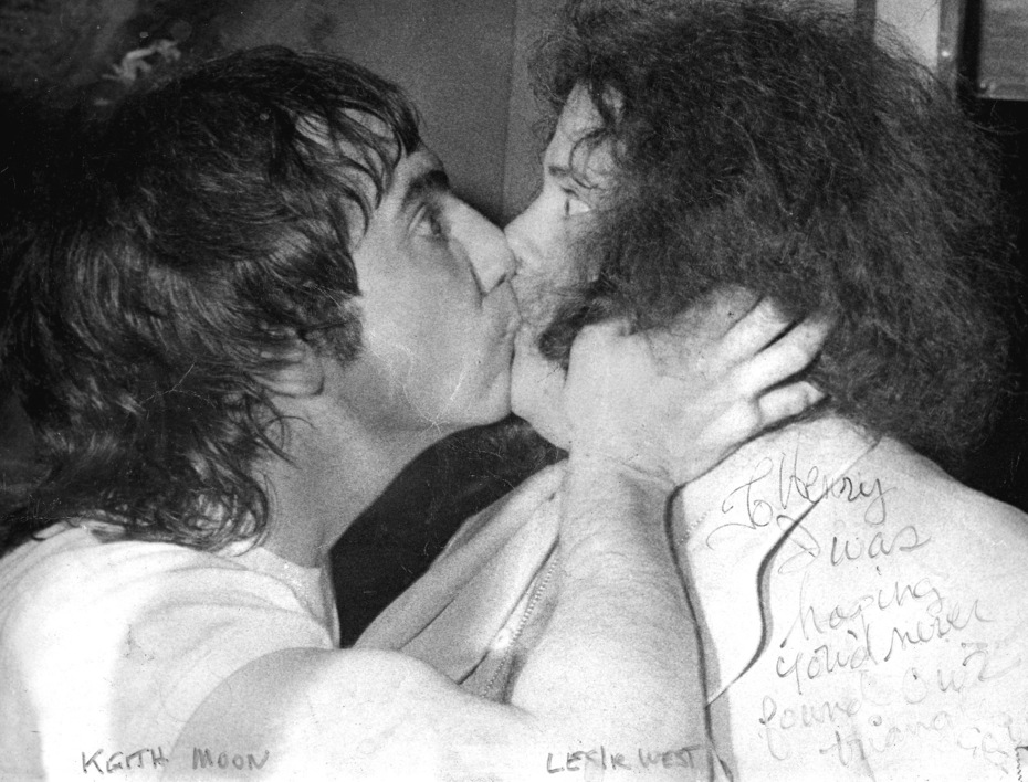 Keith Moon Kisses Leslie West, see interview in The Artists to hear Leslie tell the story!