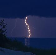 Lightning strikes water near boats. Taken at Ludingnton State Park. Michigan