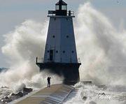 Michigan's Ludington lighthouse, large waves and foolish photographer