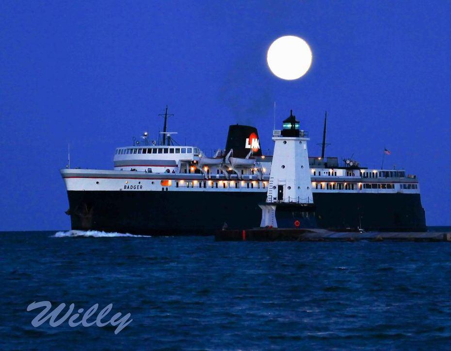 SS Badger entering Michigan's Ludington Harbor in the moonlight