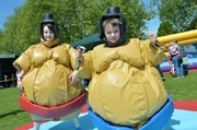 Family activities in the park included rides and Sumo suit battles for children, pictured Lucy (12) and Nathan (8) Phillips.