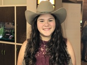 A Girl sings best with her boots and Hat!