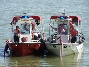 LFD Boats 8 & 9 working at a Lake Cities FD fire