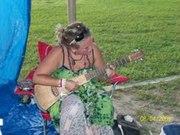 Ali playing guitar