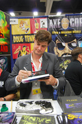 Doug TenNapel at the booth he shares with Axe Cop