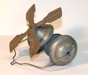 Unknown bell toy with whirlygig