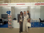 Sarah and Inam, Diplo Foundation fellows, at the booth