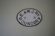E & W Junc Rly boundary marker plate cast by the Royal Label Factory Stratford on Avon circa 1907