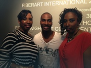 My wife and her twin sister with Eric Darius after the concert