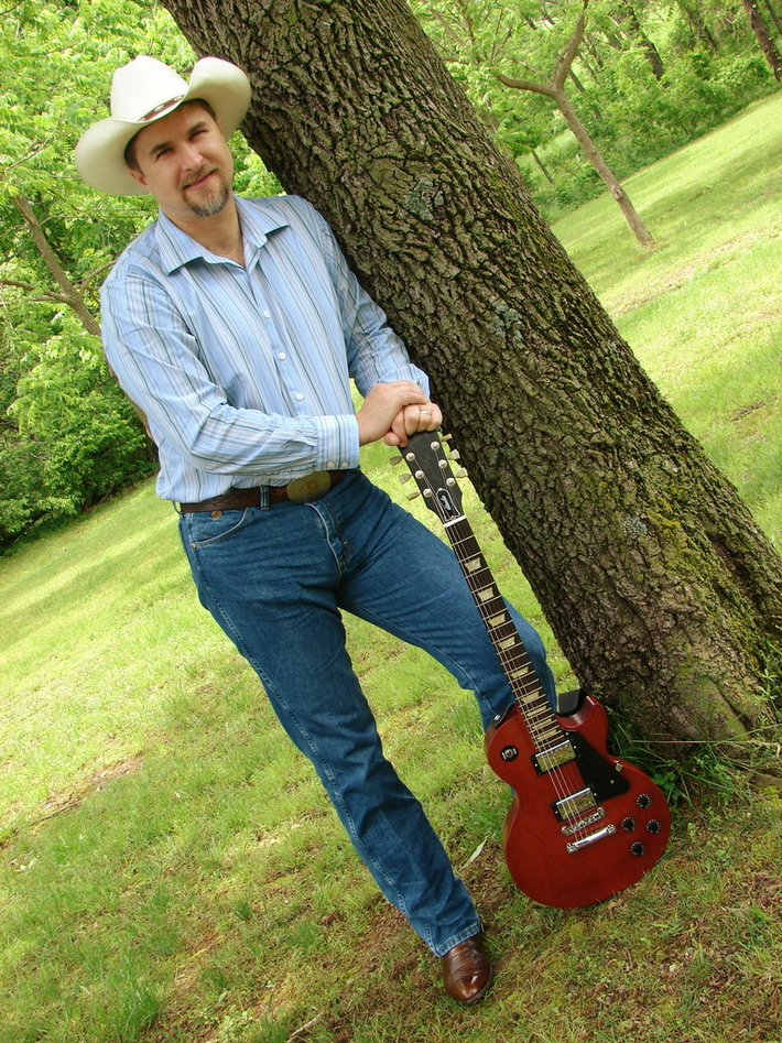 Leaning on a tree with my Gibson