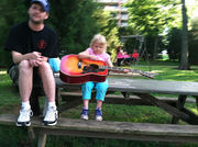 Matthew of The Snares giving a guitar lesson to a fan in Centennial Park, Nashville Tn