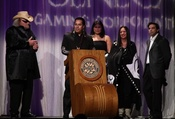 Doc Holiday accepting the Native American Music Award with his artist RED HAWK