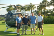 Left to right. Bruce Woodrell, Banyan Air Service, Adam Miller, ELEVATE Social and pilot of the HangarChat.com helicopter; Brad Elliott, Showalter Flying Service, and thrower of golf