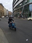 Berlin, old man with grey beard on Vespa