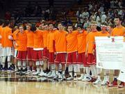 Fairview boys team display the pledge to their fans.