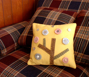 Yellow felt cushion