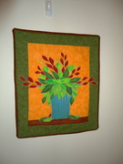 Quilted blue plant & vase applique wallhanging
