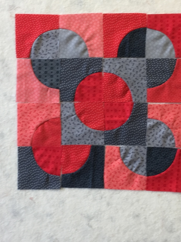 Quilt Block - Pieced Circles in Red, Grey Silver and Black Fabrics