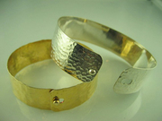 Mindy Recht - click clasp bangles 14k gold, sterling silver