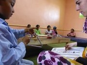 Children in Western Sahara Desert using Stave House method