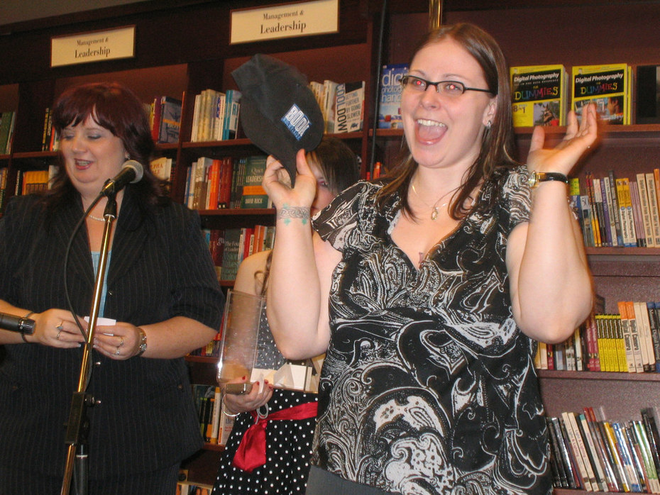 A happy fan wins a Book Television hat