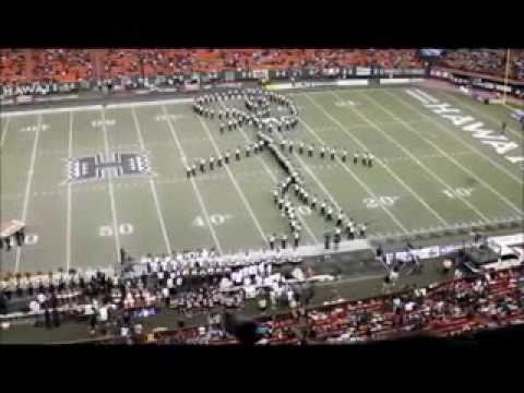 University of Hawaii Marching Band forms giant stick football player; kicker