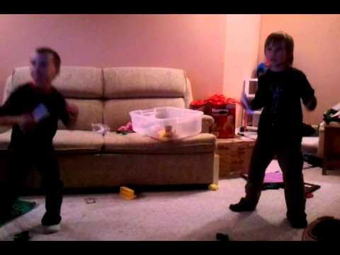 Damien and Kaleb playing Michael Jackson wii game