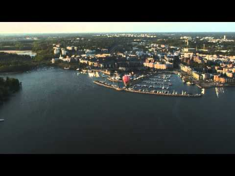 Marimekko Unikko hot-air balloon flying above the silhouette of Helsinki