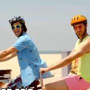 Two men on a double bike