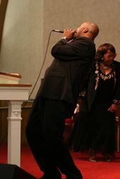 Leaning back singing a song from Bishop Brian Anderson- Payne