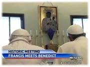 pope francis and benedict in front of black madonna