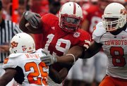 Nebraska Husker Castille carries football
