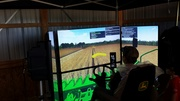 Cool Combine Training Simulator at John Deere COFS Exhibit