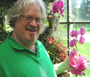 TODD HOLDING THE ORCHIDS