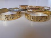 Pulseras con  la carta astral impresa. Oro, palta o bronce