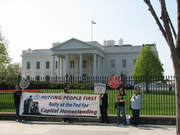 Coalition for Capital Homesteading banners before the White House