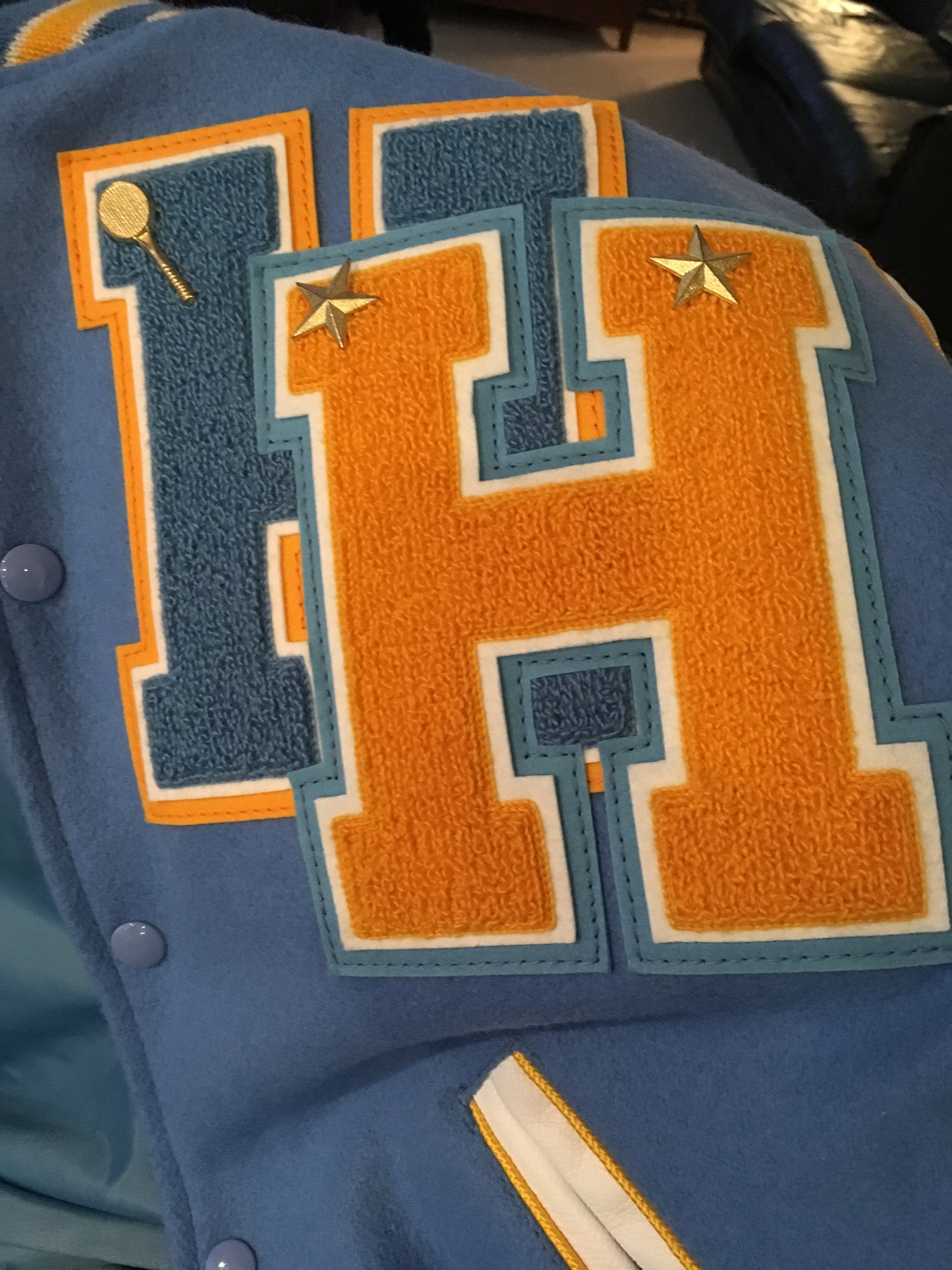 THE BLUE LETTER H IS TUNAKAIMANU'S SPORTS LETTER & AND GOLD LETTER H IS HER ACADEMIC'S LETTER. MALO SISU. H STANDS FOR HERITAGE HIGH SCHOOL.