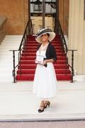 Paulette West MBE outside Buckingham Palace