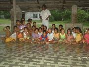 Children sitting in the Manaeaba on Banaba 2004