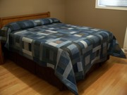 """Denim quilt with embroidered """"Paisley Quilt Blocks"""" by Designs by Sick"""