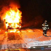 01/30/2014 01:00 hrs. School Bus Fire Timber Trail Lane Medford, NY. Yaphank Fire Department responded.  Caught this shot just as left front tire blew, notice stream of air & embers.