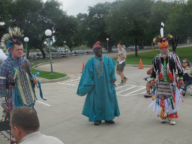 Philip with cultural dancers at shac fair