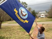 son with the navy flag